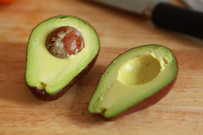 Home Cooking Recipe: Avocado is cut in half.