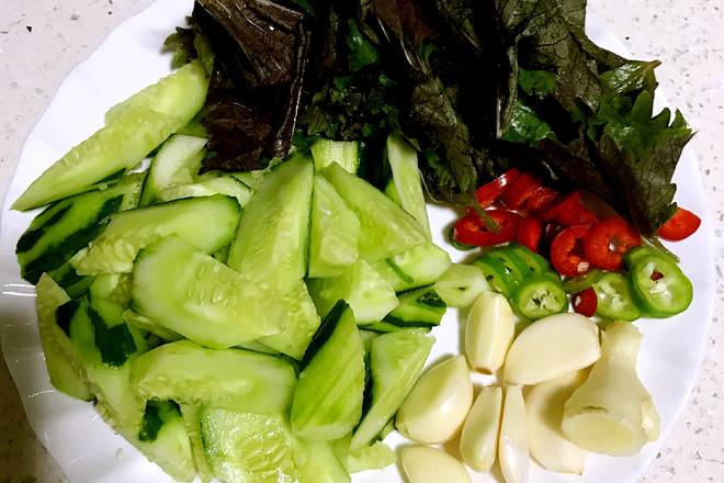 Home Cooking Recipe: Cucumber washed and peeled and cut the hob block, washed and chopped with basil, garlic, ginger washed and chopped, chopped green and red pepper.