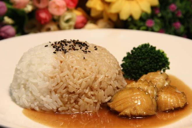 Home Cooking Recipe: The remaining juice is taken out of the onion and ginger pieces, and the starch is added to the rice and abalone, and the western blue flowers are dotted.