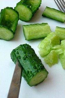 Home Cooking Recipe: Then cut along this opening, and remove the upper part of the opening of the cucumber.