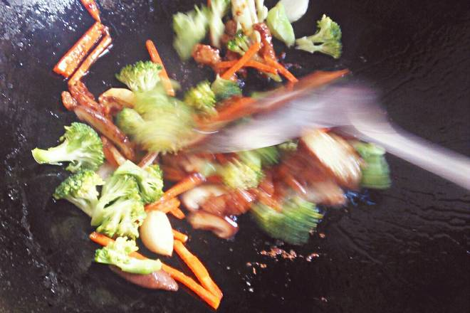 Home Cooking Recipe: Then pour in carrots, mushrooms, and broccoli for about two minutes.