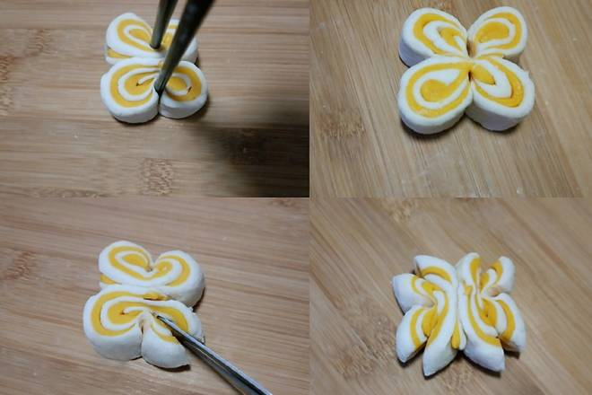 Home Cooking Recipe: Two doughs are grouped together, flattened, clamped with chopsticks as shown in the picture ~ clip like a butterfly ~ and then cut with scissors at the corners ~ a chrysanthemum roll is shaped ~