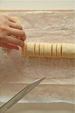 Home Cooking Recipe: Use a knife to cut the dough into biscuits about 1cm thick, and gently warm it back.